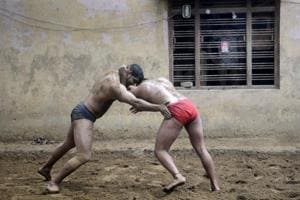 Over 100 amateur and professional wrestlers, including schoolchildren, train on a daily basis at Sukhbir Pahalwan's akhara in Sarfabad village in Noida.