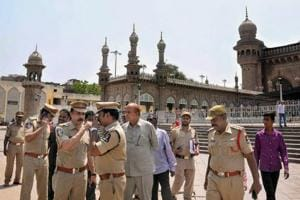 Police officials at the Mecca Masjid in old city of Hyderabad on Monday.