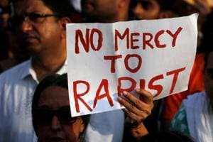 People participate in a protest against the rape of an eight-year-old girl in Kathua near Jammu, and a teenager in Unnao, Uttar Pradesh state, in Mumbai.