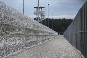 FILE - In this Feb. 9, 2016, file photo, razor wire protects a perimeter of the Lee Correctional Institution in Bishopville, S.C.