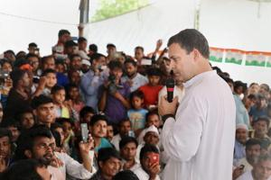 Congress President Rahul Gandhi interacts with people at Jainab Ganj in his parliamentary constituency Amethi on Monday.
