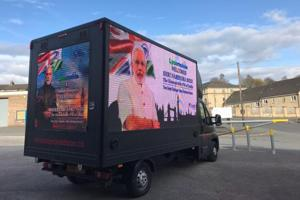 A van welcoming Prime Minister Narendra Modi to Britain.