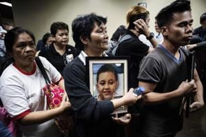 Photos: Philippines gripped by dengue vaccine scare after immunisation...