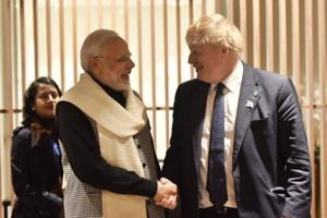 Prime Minister Narendra Modi is greeted with UK foreign secretary Boris Johnson after his arrival in London on early on Wednesday morning.