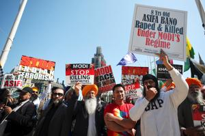 In London, PM Modi confronted by protests over rising sexual violence...