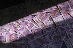 Rupee recovers from seven-month low, trades flat against US dollar