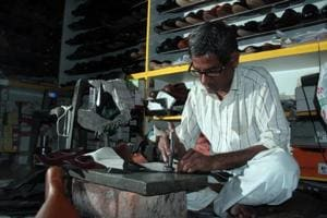 A shoemaker at Om Boot House works on his latest creation.