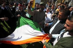 Indian flag torn as protests against PM Modi in London turn aggressive