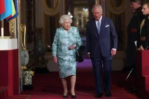 Britain's Queen Elizabeth backs her son Charles to take on...
