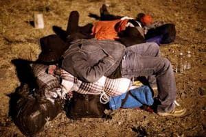 Photos: A group of migrants reach US-Mexico border, others expected...