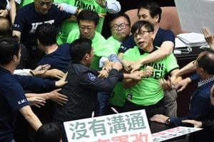 Anything goes in Taiwan parliament, lawmakers brawl over military...