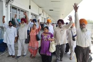 Sikh pilgrims arrive at Attari railway station, some 35km from Amritsar, as they return from Pakistan,  on Saturday.