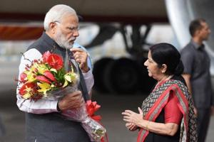 Sushma Swaraj arrives in Beijing for talks with China's top diplomat,...