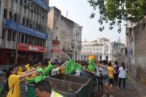 Participants of Run to Clean use biodegradable bags to collect and dispose garbage in bins, during one of their events inConnaught Place, last year.