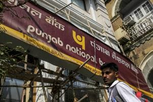 Scandals, bad debts at banks could disrupt India's economic outlook