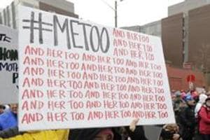 A file photo of a protestor holding up a sign with the popular Twitter hashtag #MeToo used by people speaking out against sexual harassment.