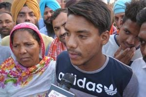 Amarjit Singh with his family members after he was deported by Pakistan on Tuesday from Attari border, in Amritsar on Tuesday.