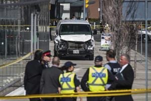 Photos: Toronto driver kills 10, injures 15 plowing van into sidewalk