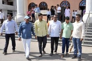 Congress corporator Vishal Kotkar (in yellow) arrested in Kedgaon double murder case in Ahmednagar on Tuesday.