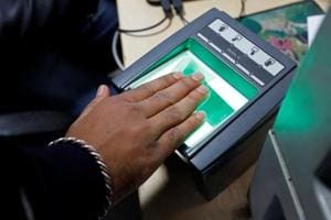 A woman goes through the process of finger scanning for the Aadhaar card at a registration centre in New Delhi.