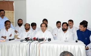 Shiv Sena chief, Uddhav Thackeray (centre) during a press conference regarding two Shiv Sena leaders who were shot dead earlier this month in Ahmednagar district , Pune