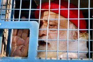 A file photo of Asaram after being taken to court.