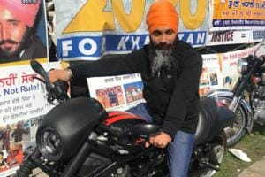Hardeep Singh Nijjar, wanted in India for targeted killings in Punjab, poses on a motorcycle in front of the Sikhs For Justice float at the nagar kirtan in Surrey last weekend.