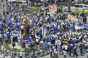 Members of Dalit community stage a protest during