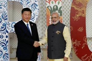 Prime Minister Narendra Modi welcomes Chinese President Xi Jinping for the BRICS Summit in Benaulim, Goa.
