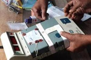 Election Commission officials seal an Electronic Voting Machine (EVM).