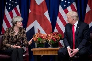 British Prime Minister Theresa May addresses the press as US President Donald Trump listens during a meeting at the Palace Hotel in New York on September 20, 2017.