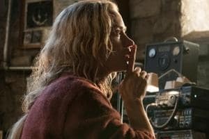 This image released by Paramount Pictures shows Emily Blunt, left, and Millicent Simmonds in a scene from A Quiet Place.