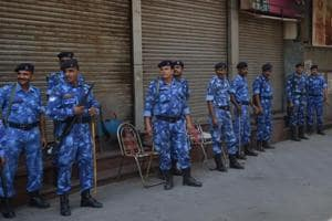 Security forces in a in bazaar amid a bandh call by caste organisations in Phagwara on Wednesday.