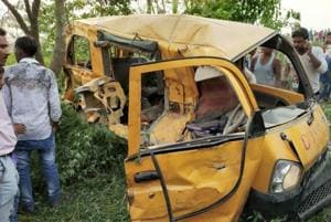 The mangled remains of the school van that was rammed by a speeding train in Kushinagar on Thursday morning.