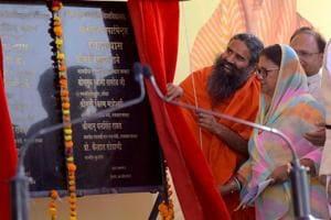 Chief minister Vasundhara Raje and Baba Ramdev at the foundation stone laying ceremony of Govind Guru Janjatiya Vishwavidyalaya, at Banswara on Wednesday.
