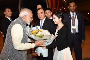Prime Minister Narendra Modi being received in Wuhan after he landed on Thursday night in China. Vice foreign minister Kong Xuanyou looks on.