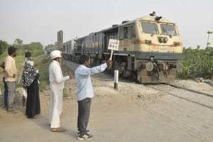 Crossing Mitra Arvind Prashad standing at the accident area in Kushinagar India on  April 27.