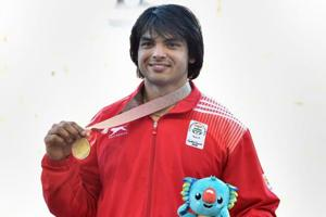 Neeraj Chopra celebrates after receiving his gold medal at the podium ceremony of men