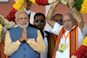 Prime Minister Narendra Modi and party's CMcandidate BS Yeddyurappa during a rally in Bengaluru.