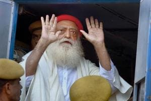 File photo of Asaram Bapu after being produced at the sessions court in Jodhpur, November 30, 2013. A Jodhpur court awarded life imprisonment to self-styled godman for raping a minor girl at his ashram in Rajasthan in 2013.