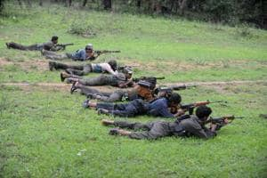 Maoists ready their weapons as they take part in a training camp in Bijapur district in Chhattisgarh in July 8, 2012.