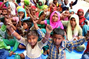 Brick-kiln labourers and their families holding a dharna opposite the mini-secretariat in Bathinda on Friday.