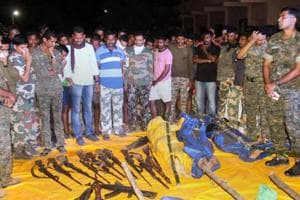 Security personnel show the guns recovered from the Maoists killed in an encounter at Broriya forest area in Bhamragad taluka of Gadchiroli district of Maharashtra on Sunday night.