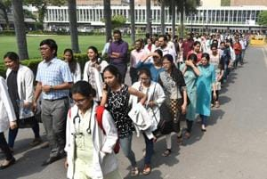 Doctors take part in a protest march around the AIIMS Campus, at AIIMS Hospital, in New Delhi, India.