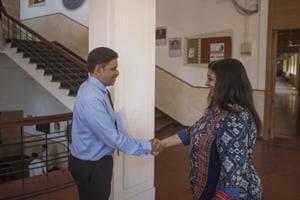 Suhas Pednekar being congratulated.
