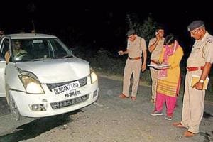 Forensic team inspecting the crime scene at Karor village in Rohtak on Friday night.