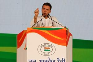 Congress president Rahul Gandhi addresses his supporters during a Jan Aakrosh at Ramlila ground in New Delhi on Sunday.