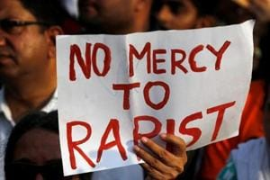 People participate in a protest against rapes in India