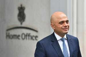 Home secretary Sajid Javid poses for photographers outside the Home Office in Westminster, London.