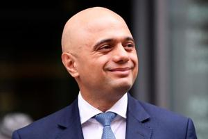 Sajid Javid stands outside the Home Office after being named as Britain